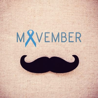 Paper Mustache and Movember on fabric toning background, Prostate cancer awareness , Men health awareness month